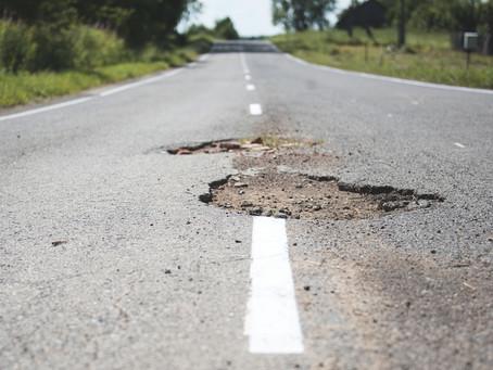 Traction Tip: Avoiding Potholes