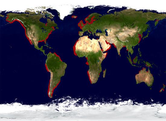 A figura retrata toda a superfície do planeta Terra com destaque para áreas de ressurgência costeira marcadas de vermelho.
