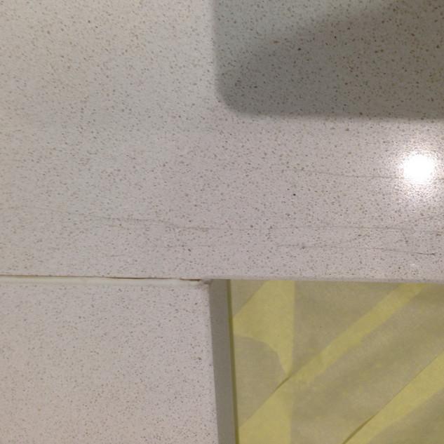 Scratched White Quartz Worktop.jpeg