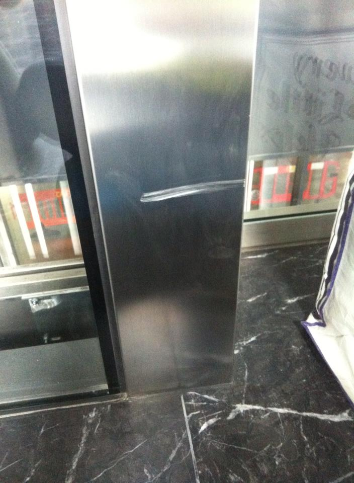 Damaged surround of lift- Before