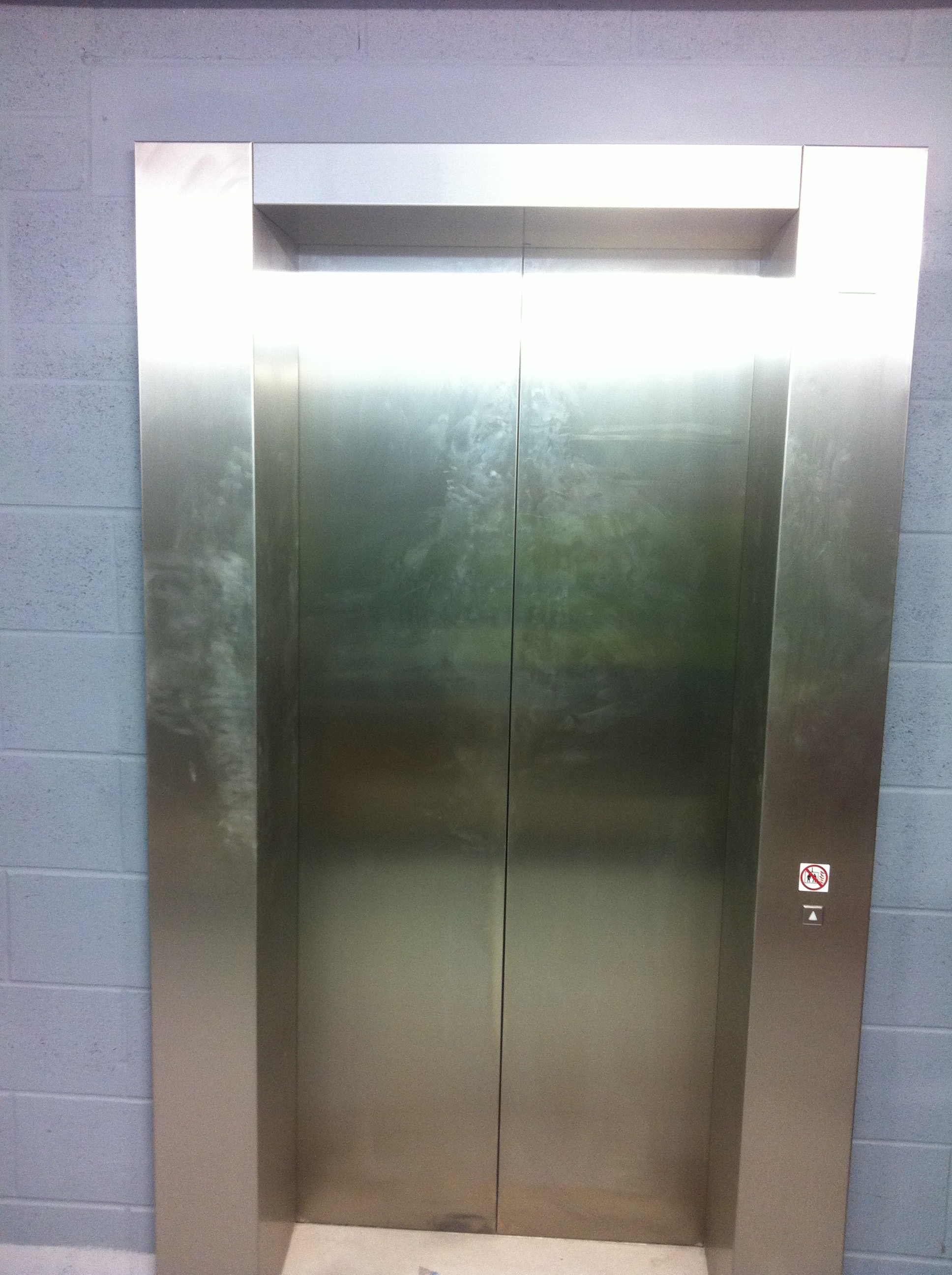 Damaged Lift Doors- Before