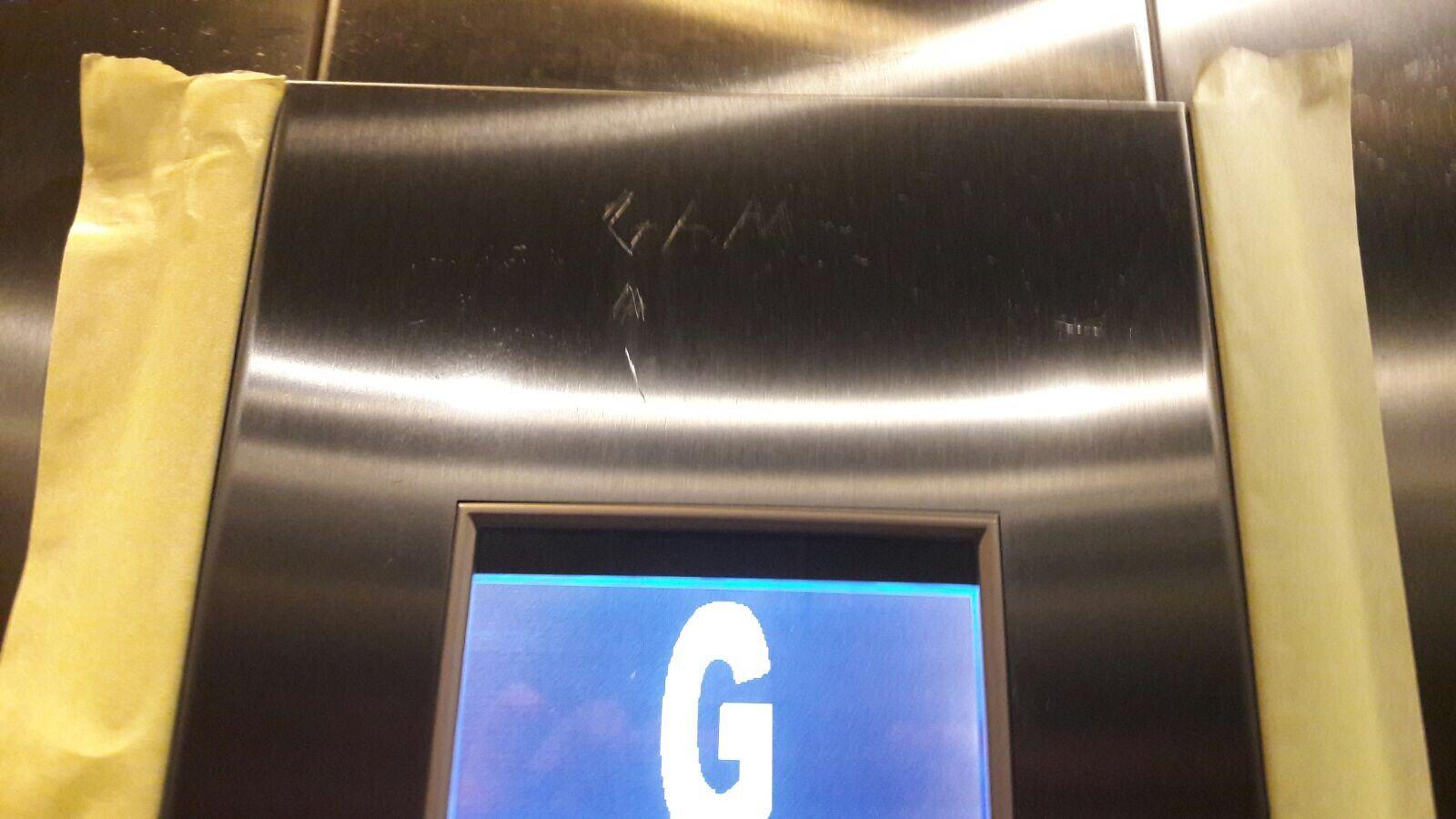 Lift control panel, graffiti removal