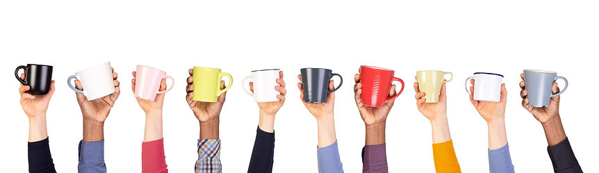 Cups of coffee or tea in hands isolated