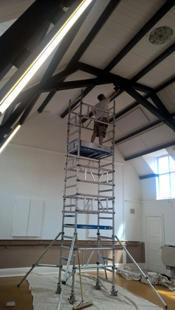 Tower erected to paint ceiling