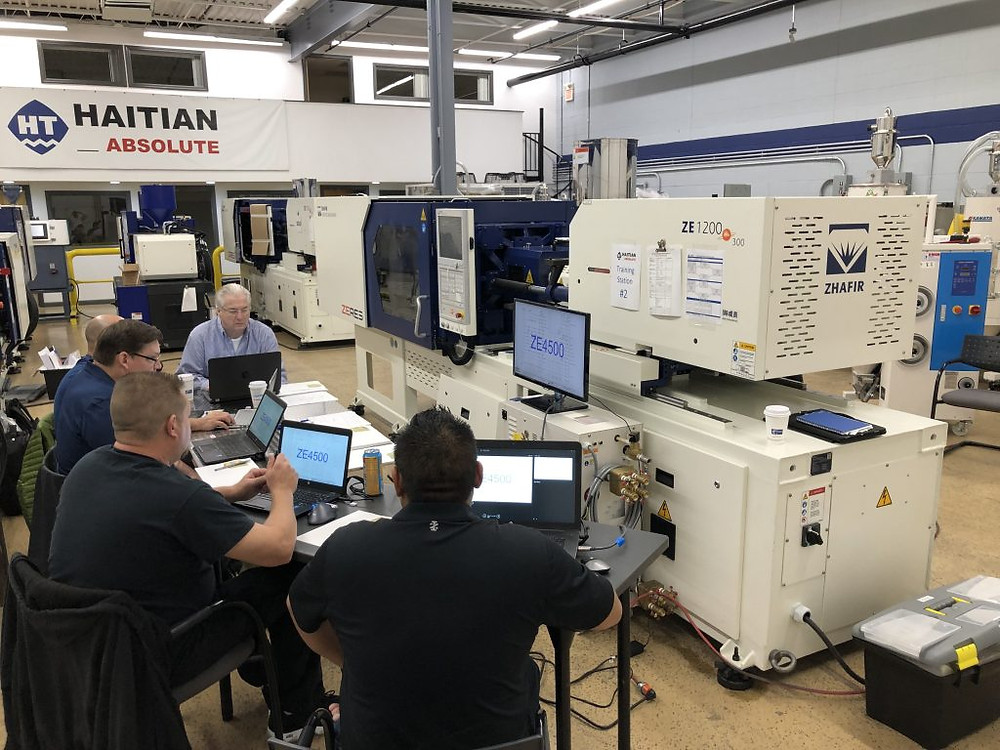 Field service engineers were broken up into small groups to dig deep into the individual injection molding machine models from Haitian