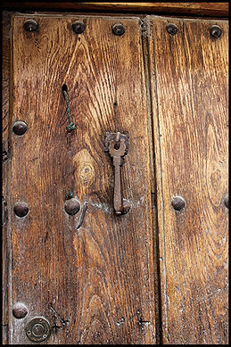 ancient door and key in Granada