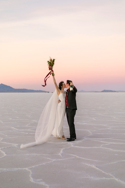 Bonneville Salt Flats Bride and Groom with Champagne