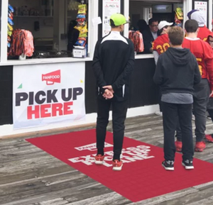 Mockup of a floor mat in front of a concession stand