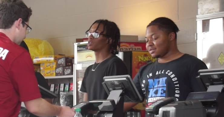 Cashiers working at a typical concession stand.