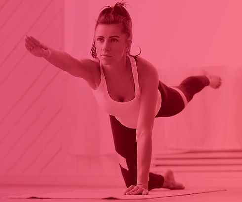 attractive-brunette-woman-doing-yoga-at-