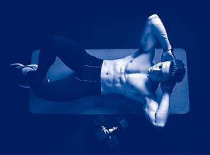 shirtless-man-training-abs-on-mat.png