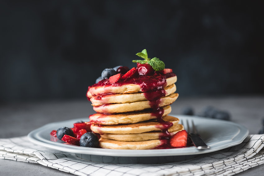 Pancakes with berry sauce and berries ov