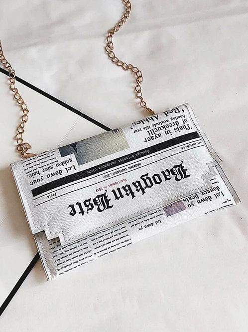 "XA ""Big News"" clutch purse"