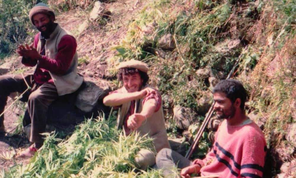 Frenchy making charas with locals in Malana circa 1985