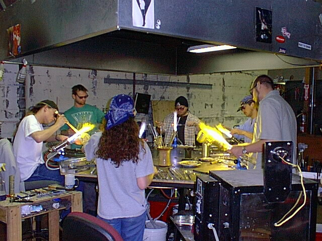 Glassblowers at the round table
