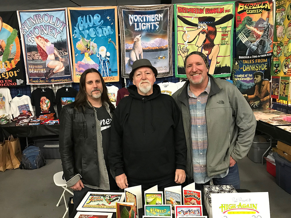 World of Cannabis executive director Bobby Black with artist Pat Ryan and Vince Dugar of Golden Frog Press.