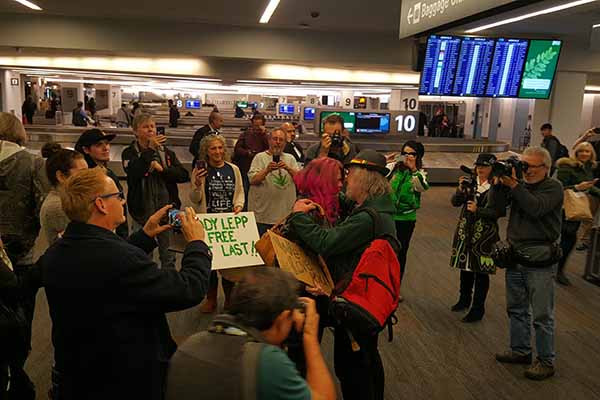 Friends greet Eddy Lepp upon arrival at SFO after release from prison.