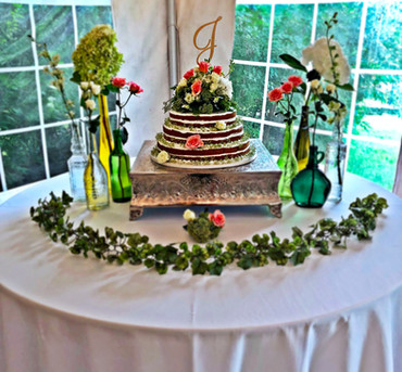 Cookie cake wedding cake featuring live flowers!