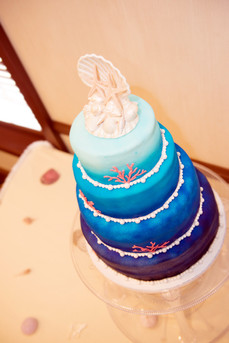 "4-Tier ombre ""under the sea"" cake featuring custom chocolate shells and coral!"