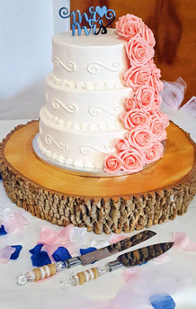 3-Tiered cake featuring piping and flower cascade!