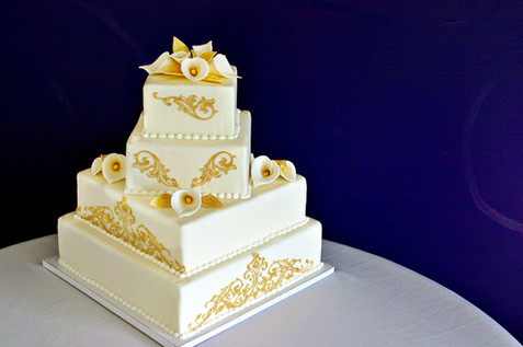 4-Tier offset square cake featuring custom gum paste calla lilies bouquets and edible gold lace work!