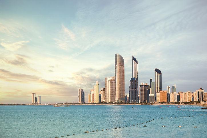 Abu Dhabi Skyline Corniche at sunset .jp