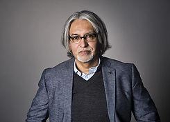 1-portrait-of-middle-aged-hispanic-man-with-long-gray-hair-leland-bobbe-1.jpg