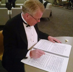Cary reviewing music score.