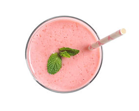 Glass with tasty strawberry smoothie on