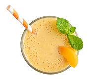 Glass of apricot milkshake or smoothie w