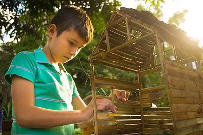 boy-making-wooden-house-miniature-238791