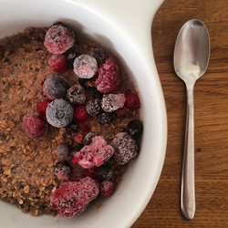 Chocolate Proats and Frozen Berries this morning after a nice set of arms and abs at the gym this mo