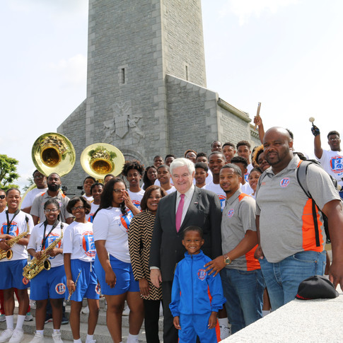 Former Speaker of the House with Marching Band in D-Day Commemoration