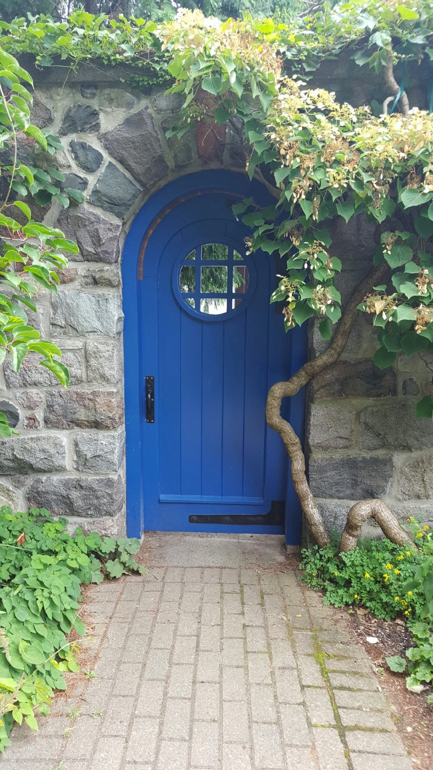 Stone wall with blue door. Photo by Diana Dinverno