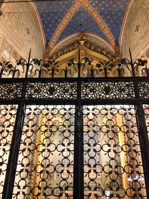 Florence gate with Florentine lily motif. Photo by Diana Dinverno
