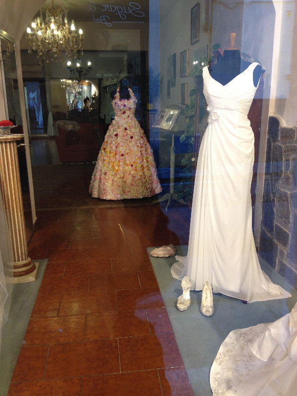 Gowns in window display in Florence. Photo by Diana Dinverno