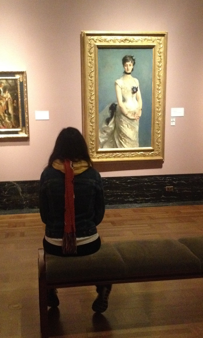 Young woman viewing John Singer Sargent painting.