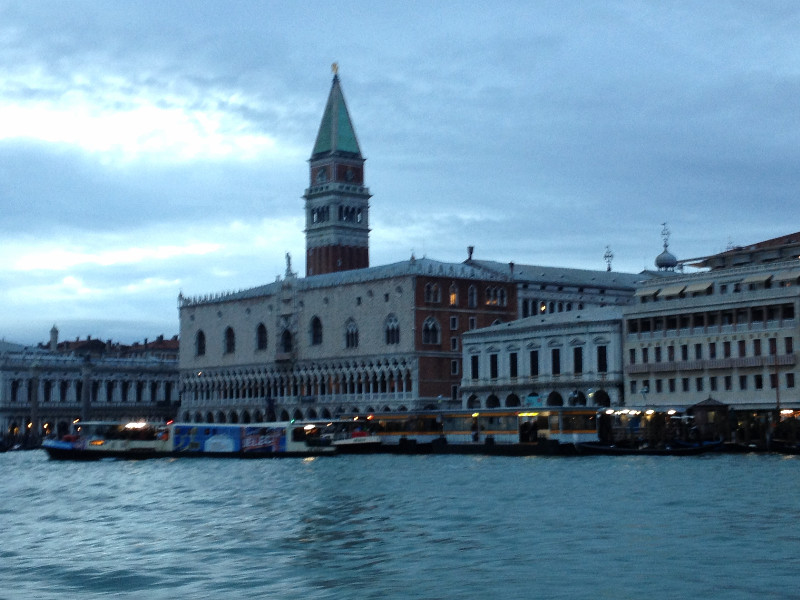 View of the Doge's Palace and campanile from the deck of a vaporetto.