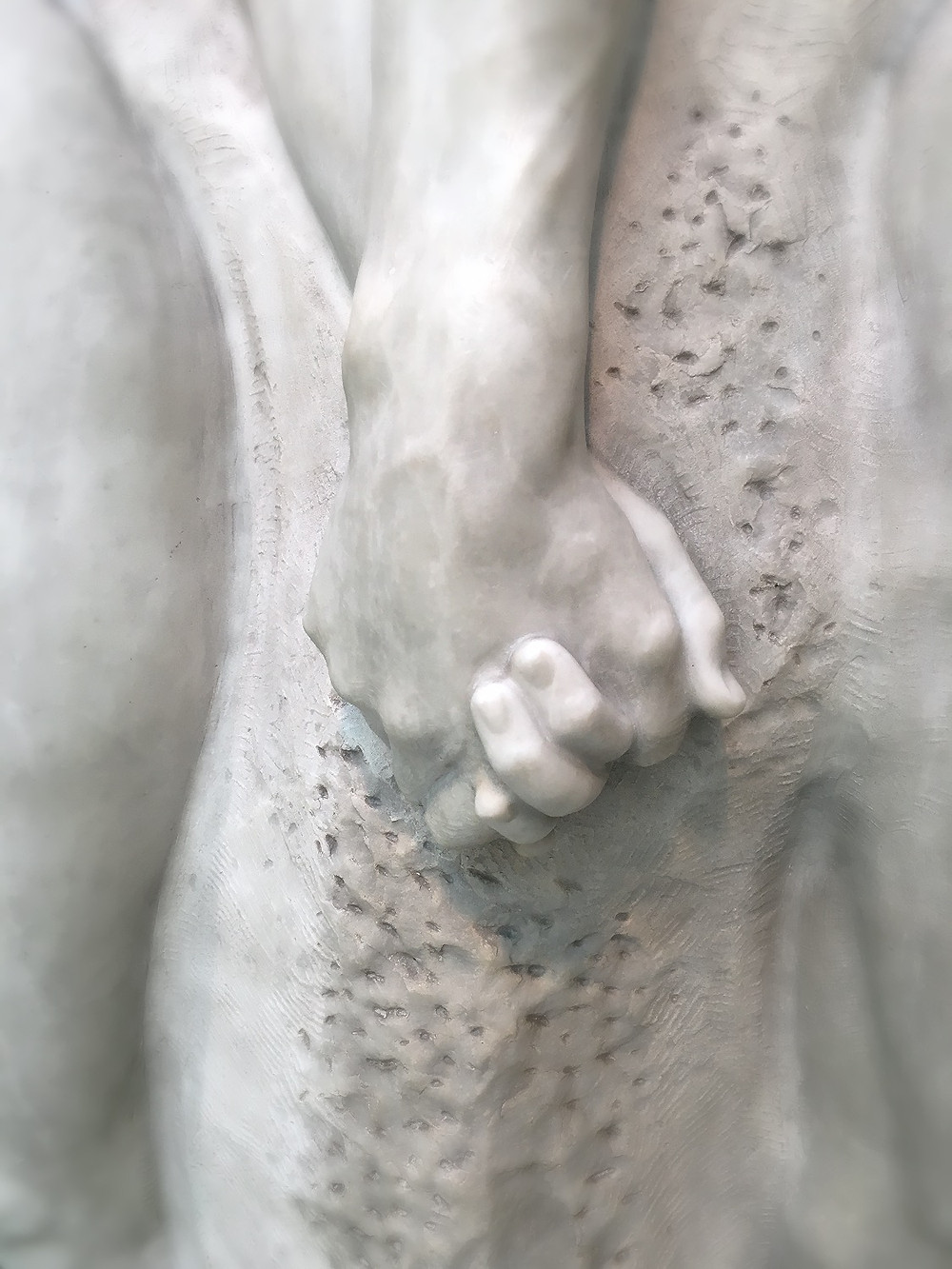 Sculpture  of clasped hands. Photo by Diana Dinverno
