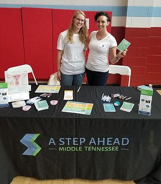 Caina and volunteer Anna Grace at a community health fair