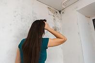 girl kills mold at home.jpg