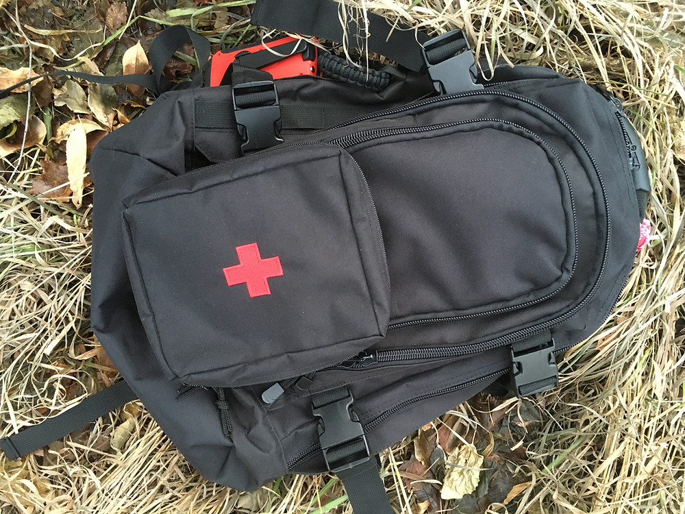 tactical survival backpack with MOLLE first aid pouch