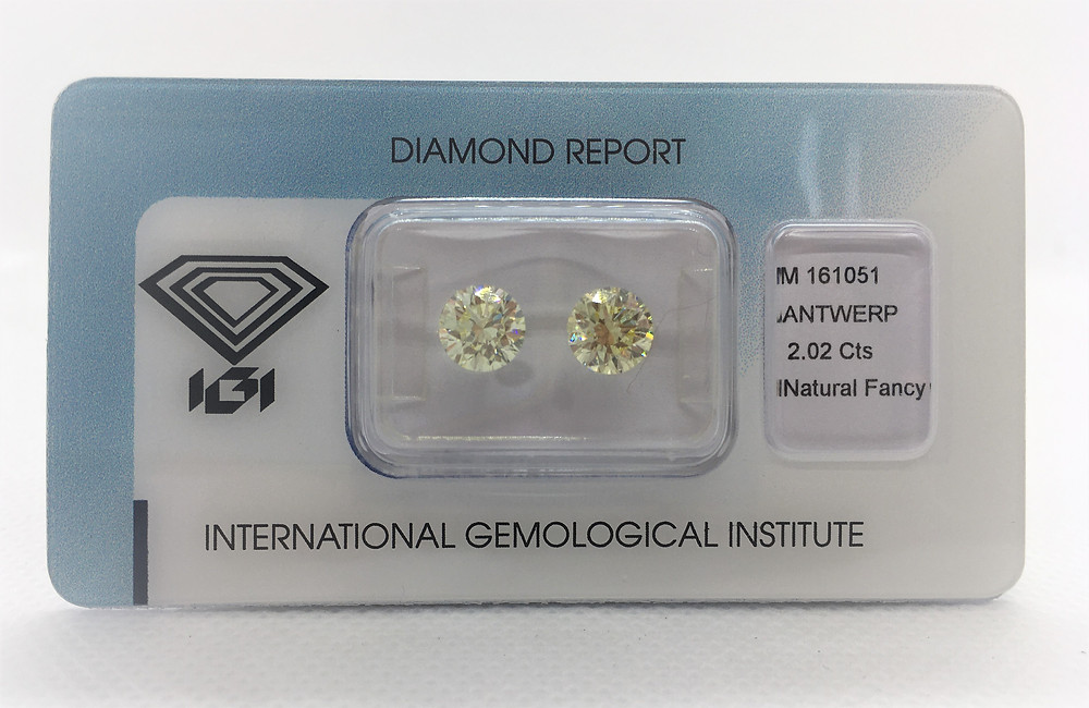 Couple of Fancy Light Yellow Round total weight 2.02ct certified by IGI