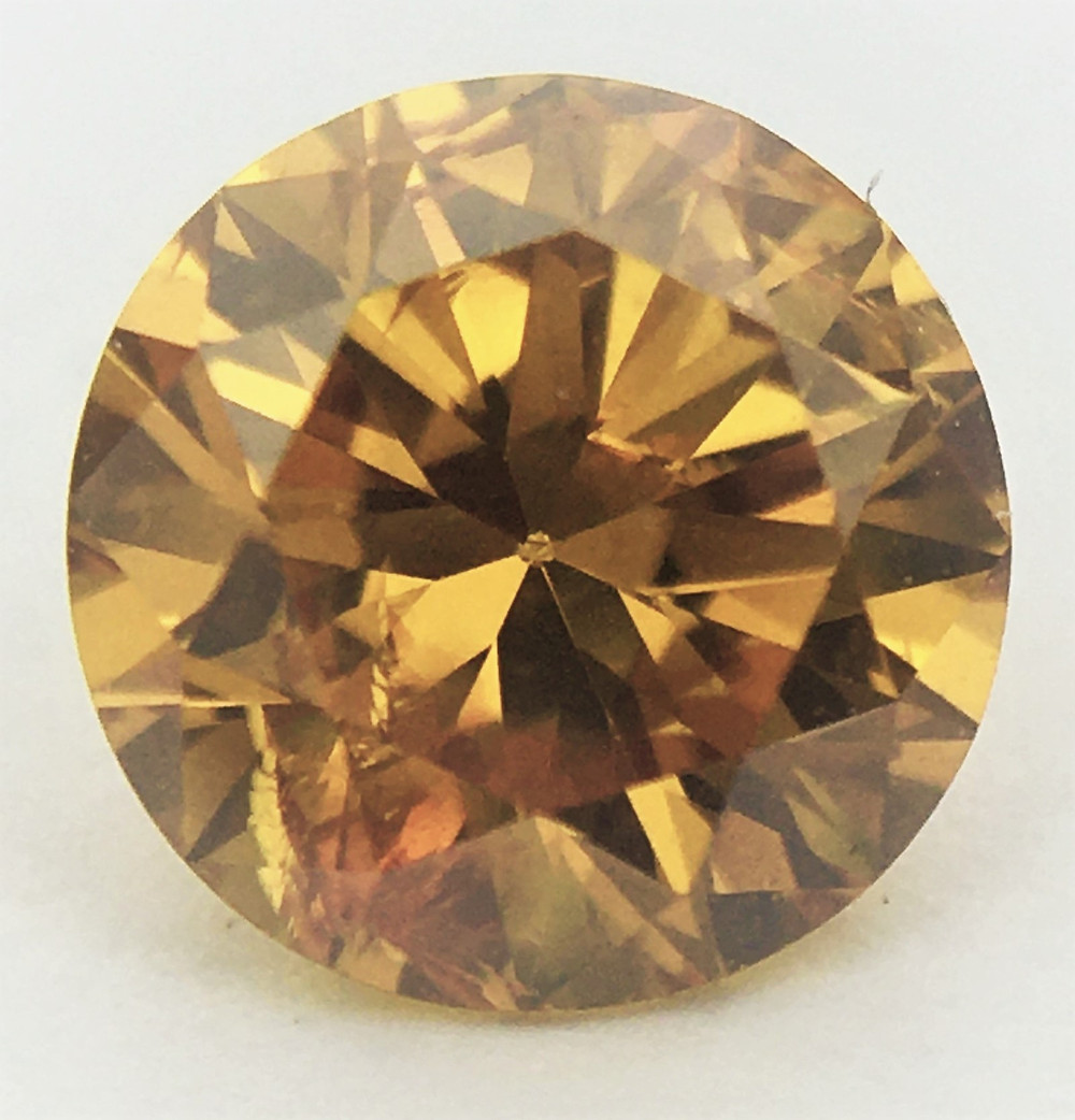 Round 0.39ct Fancy Vivid Orange certified by GIA