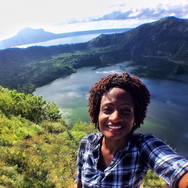 smiling-black-woman-taking-a-selfie-duri