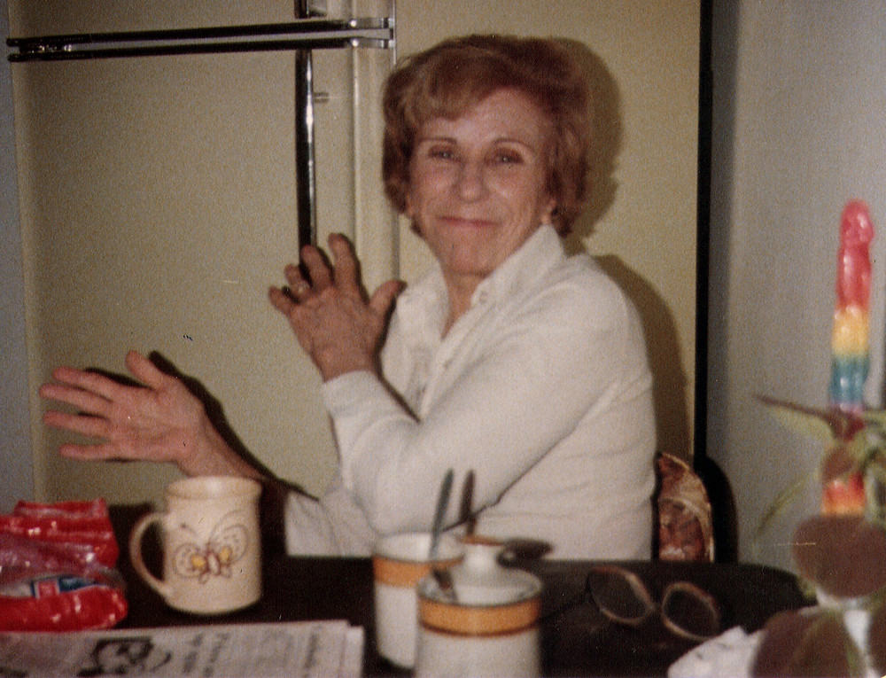 Helen Marquis sitting at the breakfast table smiling and brushing her hands