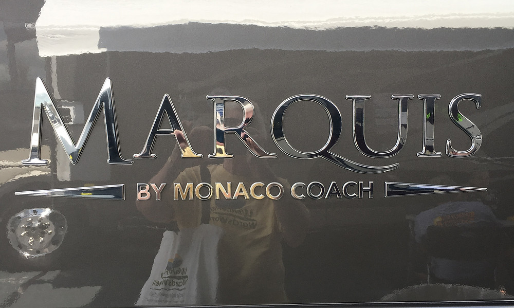 The side of a Class A motorhome name Marquis by Monaco Coach