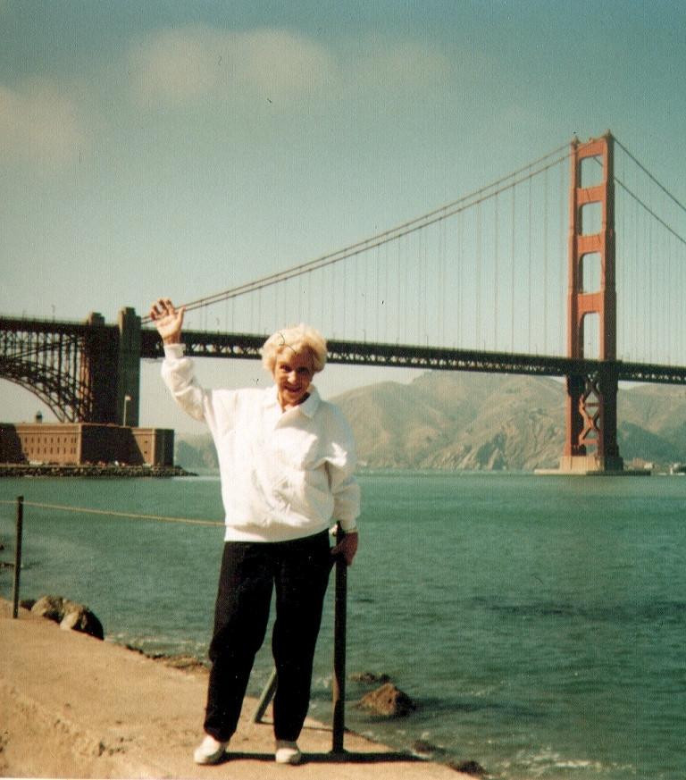Helen Marquis waving at the Golden Gate Bridge