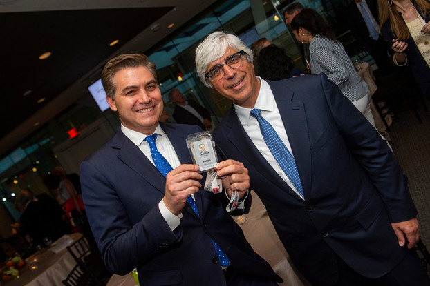 Jim Acosta displays his White House Press Pass with attorney and Law winner, Ted Boutrous