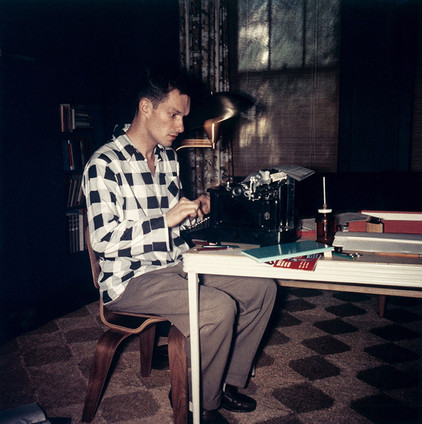 Hef typing away in his Chicago apartment